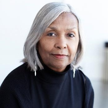 grey haired woman of color