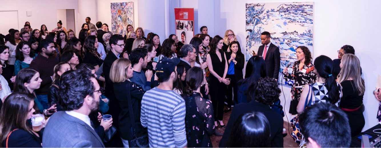 a large crowd at a gallery event